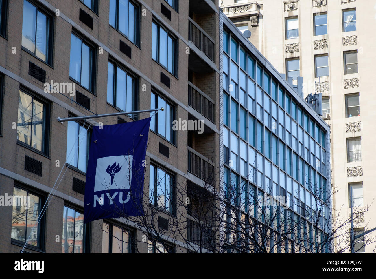 New York University building in Greenwich Village with Flag on extended flagpole. New York City. March 2018 - Stock Image