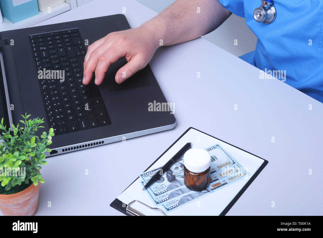 View of Details of doctor hands typing on keyboard - Stock Image
