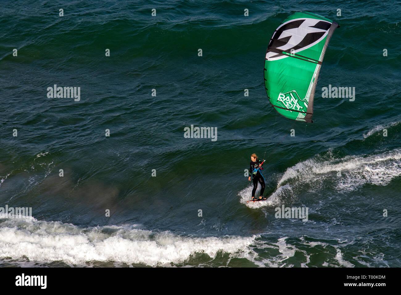 Female Kitesurfer off the coast of Lauderdale-by-the-Sea, Florida, USA - Stock Image