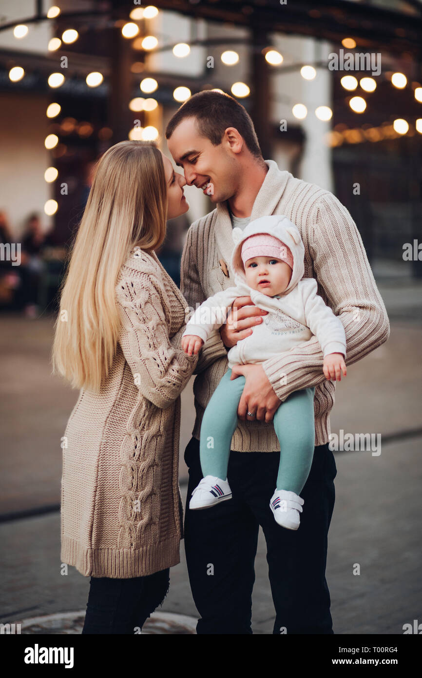 Portrait of family standing together in cosiness atmosphere. Stock Photo