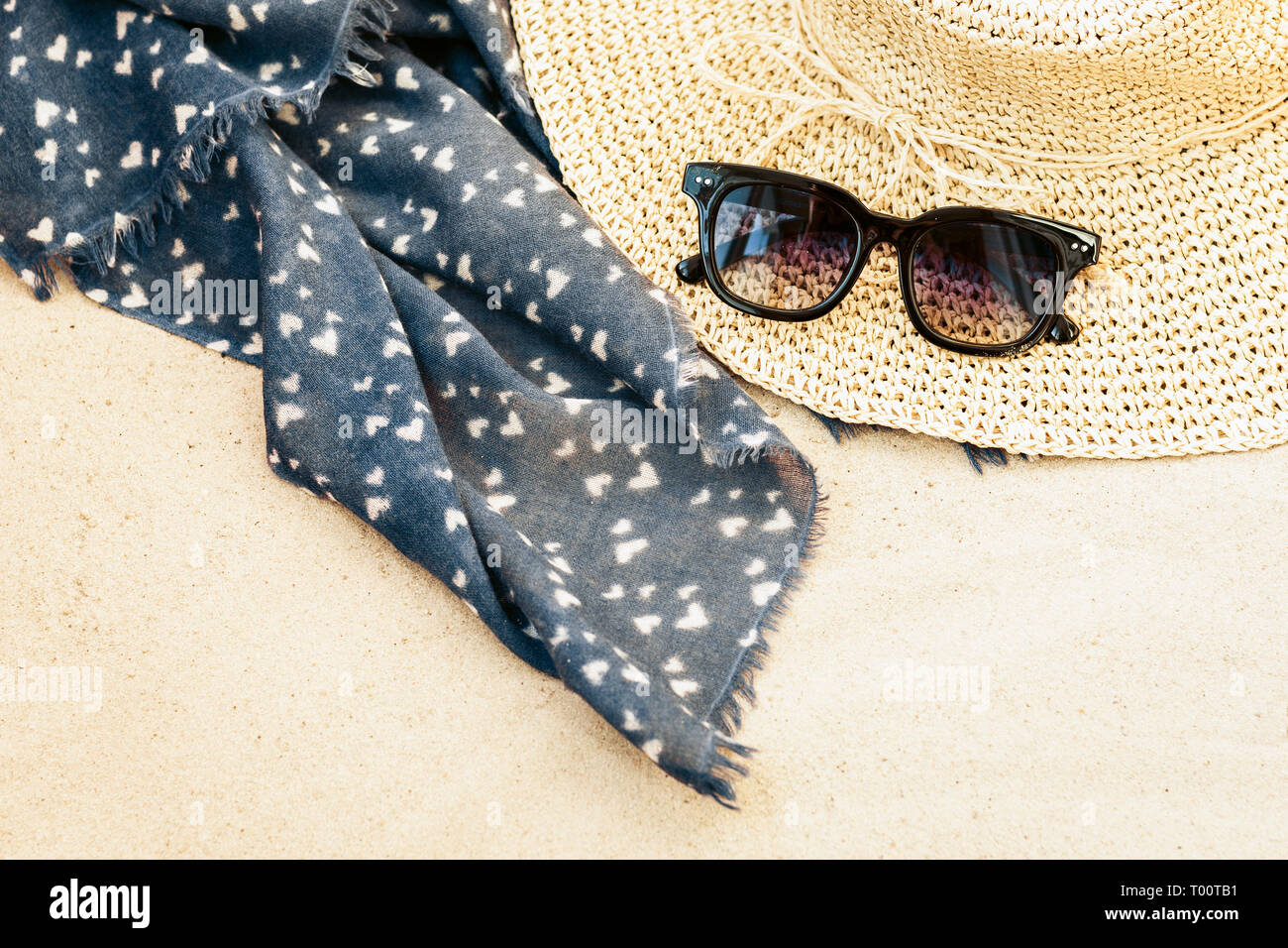 2dacd8b0 Vintage summer wicker straw beach bag, sun glasses and bag on the sand -  Stock