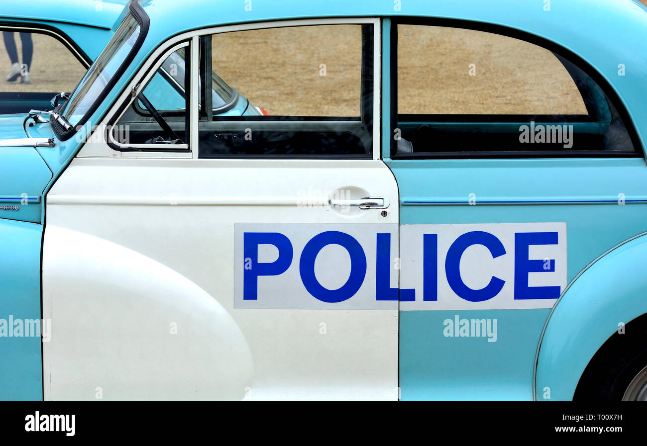 London, UK. 8th March 2019. Police Morris Minor 1000 (1969) in a display of old Police Cars in Horse Guards Parade to coincide with a march to celebra Stock Photo