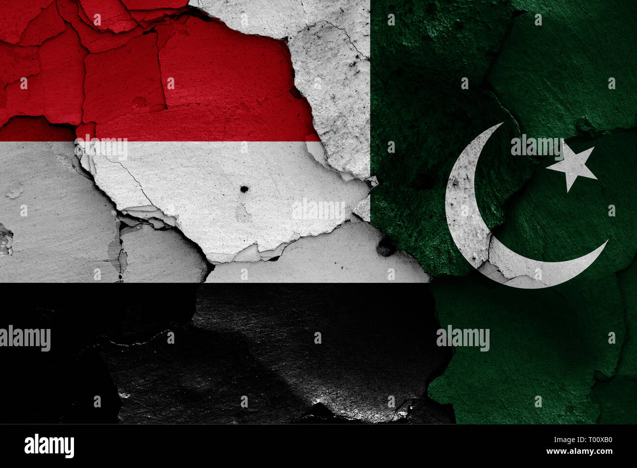 flags of Yemen and Pakistan painted on cracked wall - Stock Image