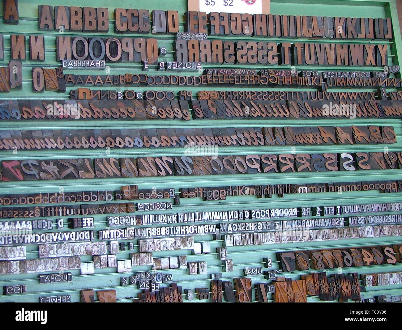 Off set printers wall set of iron letters - Stock Image