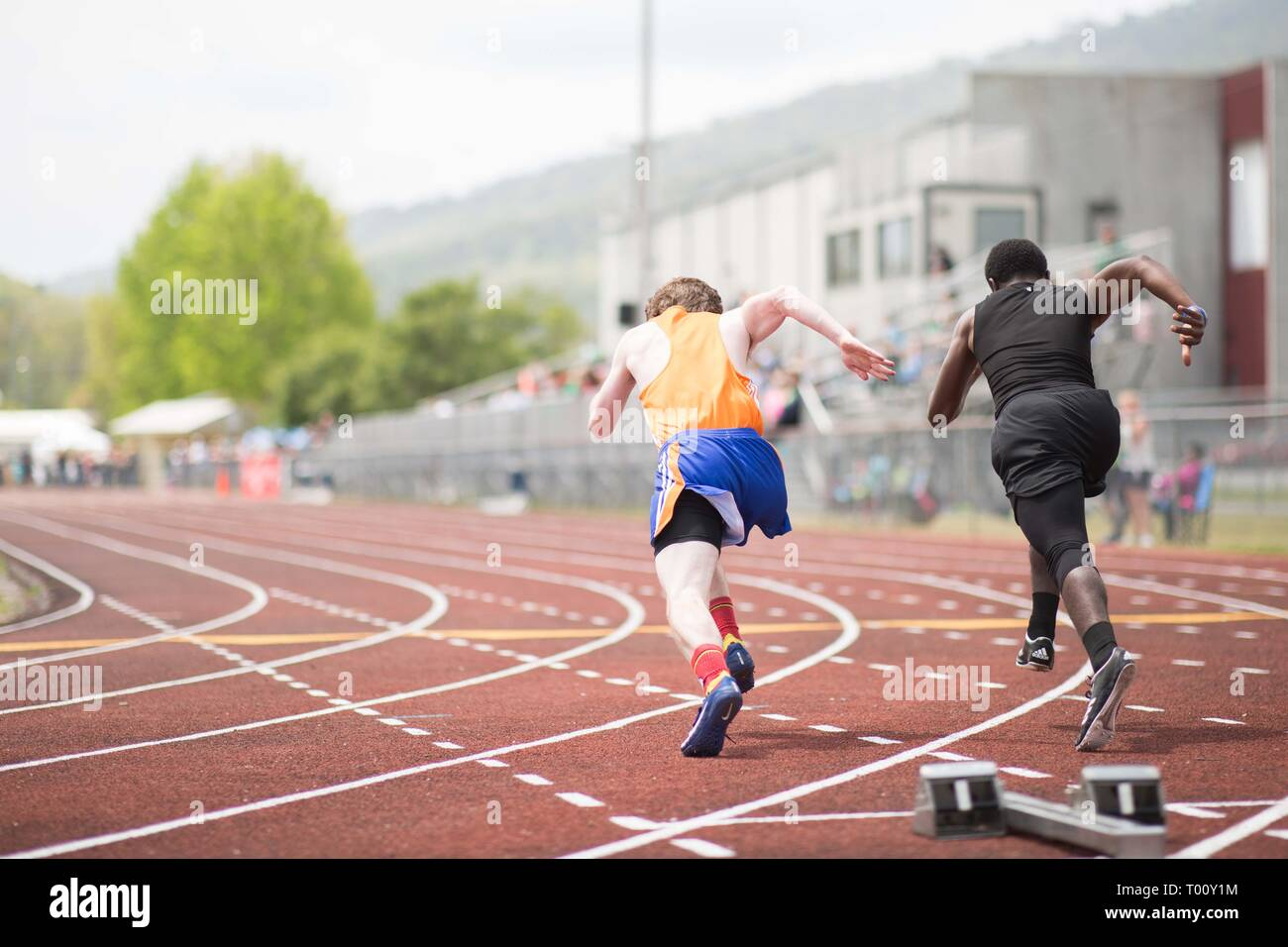 High school students participate in a track and field 100 meter dash race - Stock Image