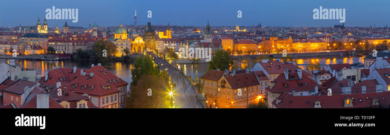 PRAGUE, CZECH REPUBLIC - OCTOBER 15, 2018: The panorama of the city with the Charles bridge and the Old Town at dusk. Stock Photo