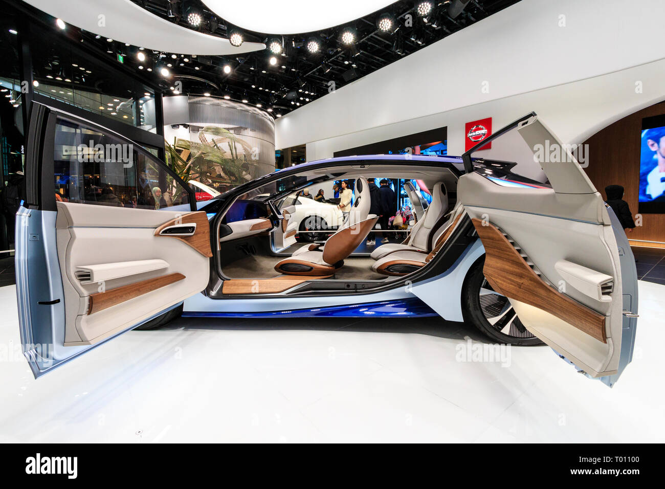 Nissan flagship showroom on the Ginza in Tokyo. Display of the concept car, the electric Nissan IDS, with open doors on roped off white circle area. - Stock Image