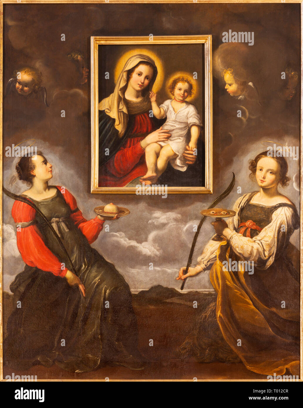 PARMA, ITALY - APRIL 17, 2018: The saints Lucy and Agata adoring the image of Madonna in church Chiesa di Santa Lucia by master of Parma school - Stock Image