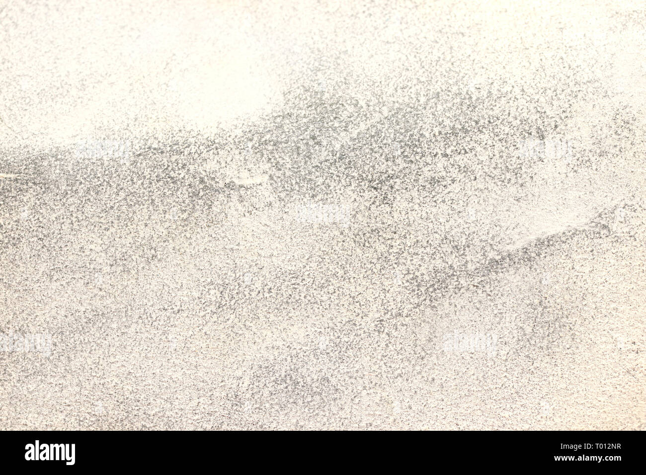 White Sandpaper Attrition Rubbing Texture. Rough Grit Abrasive Background. Used Grain Emery Backdrop. - Stock Image