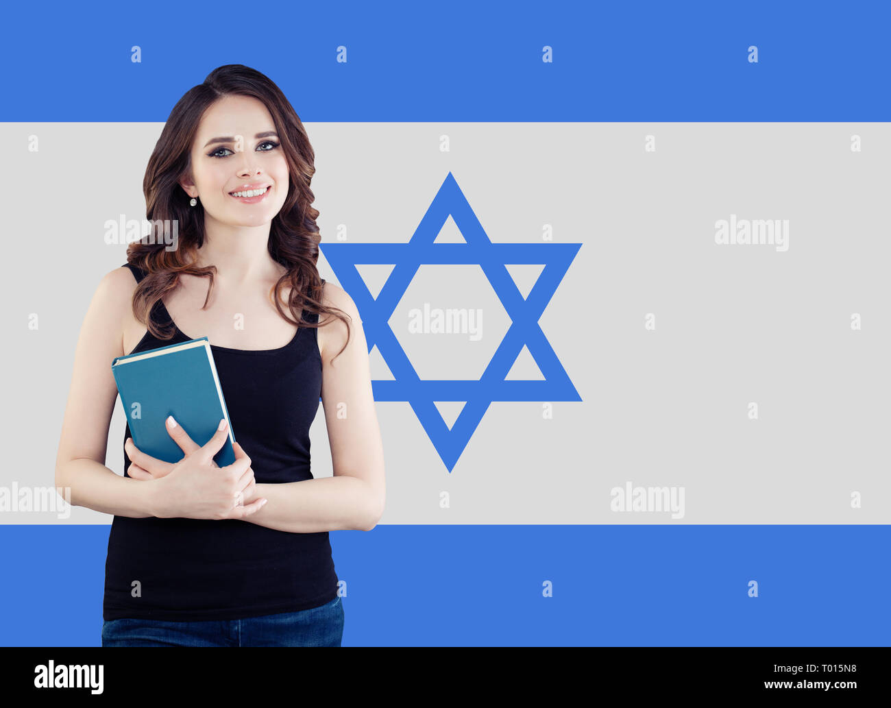 Live, work, education and internship in Israel. Cheerful pretty young woman with Israel flag - Stock Image