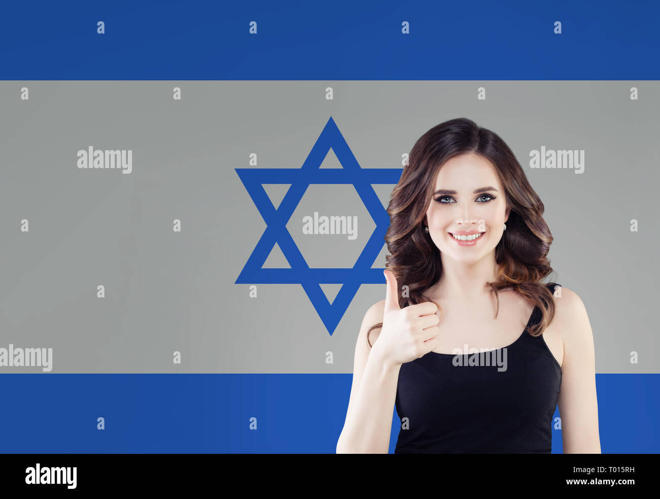 Beautiful happy young woman against the Israel flag background. Live, education and work in Israel - Stock Image