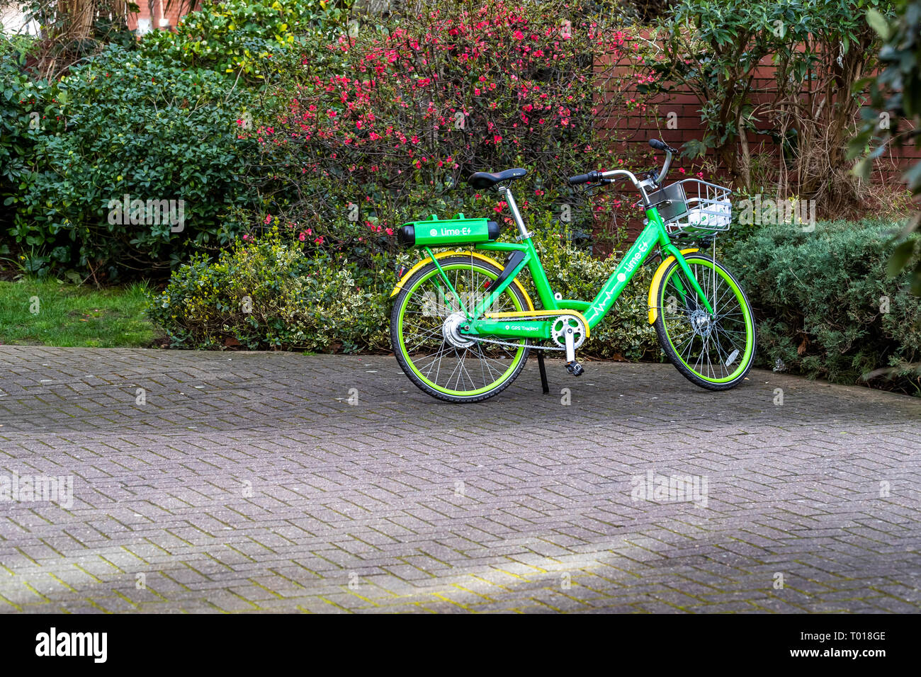 Communal bicycles bookable by mobile device app for use by