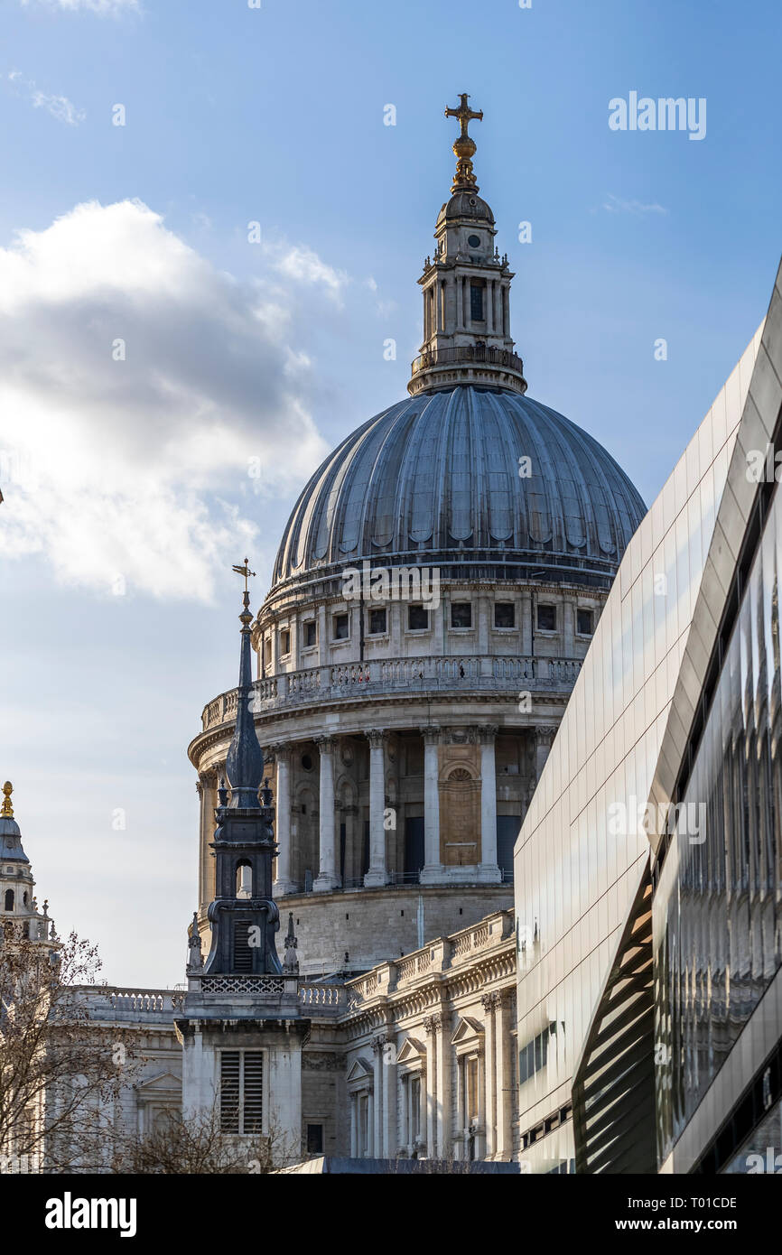 The dome of St Paul's Cathedral from New Change, with the black spire of St Augustine Watling Street in front. London. - Stock Image