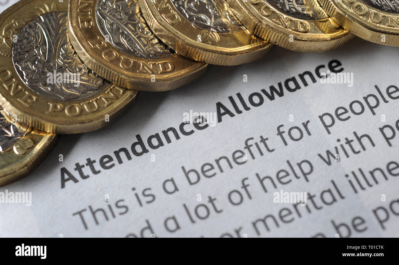 DWP  ATTENDANCE ALLOWANCE PAYMENT LEAFLET WITH ONE POUND COINS RE BENEFITS THE ELDERLY PENSIONERS LOW INCOME PENSION CREDIT ETC UK - Stock Image