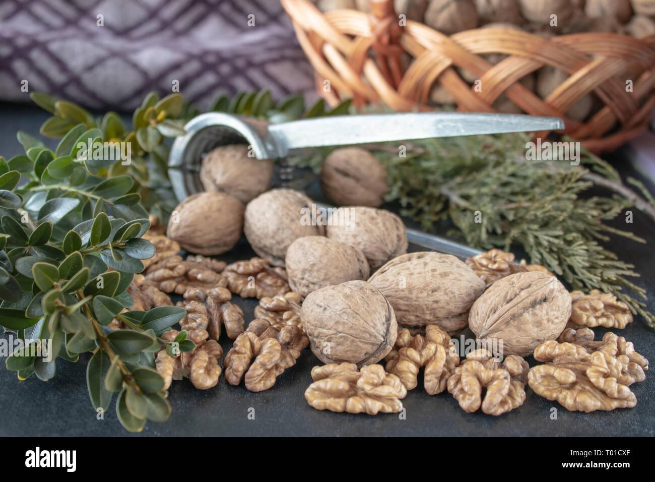 Walnuts on a black background, walnut kernels. Healthy food from walnut. Close-up. Stock Photo