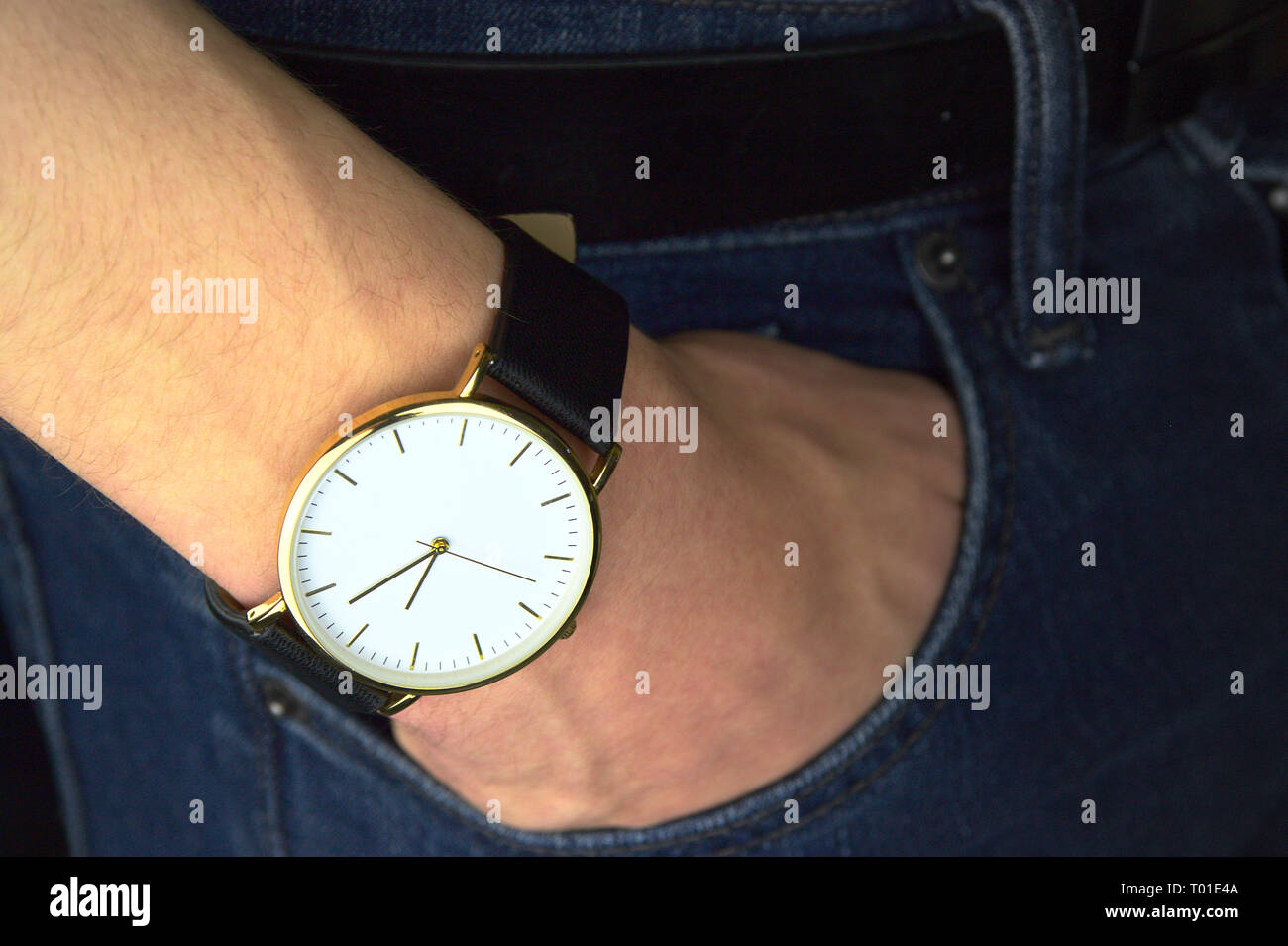 Close-up of wristwatch on wrist. - Stock Image