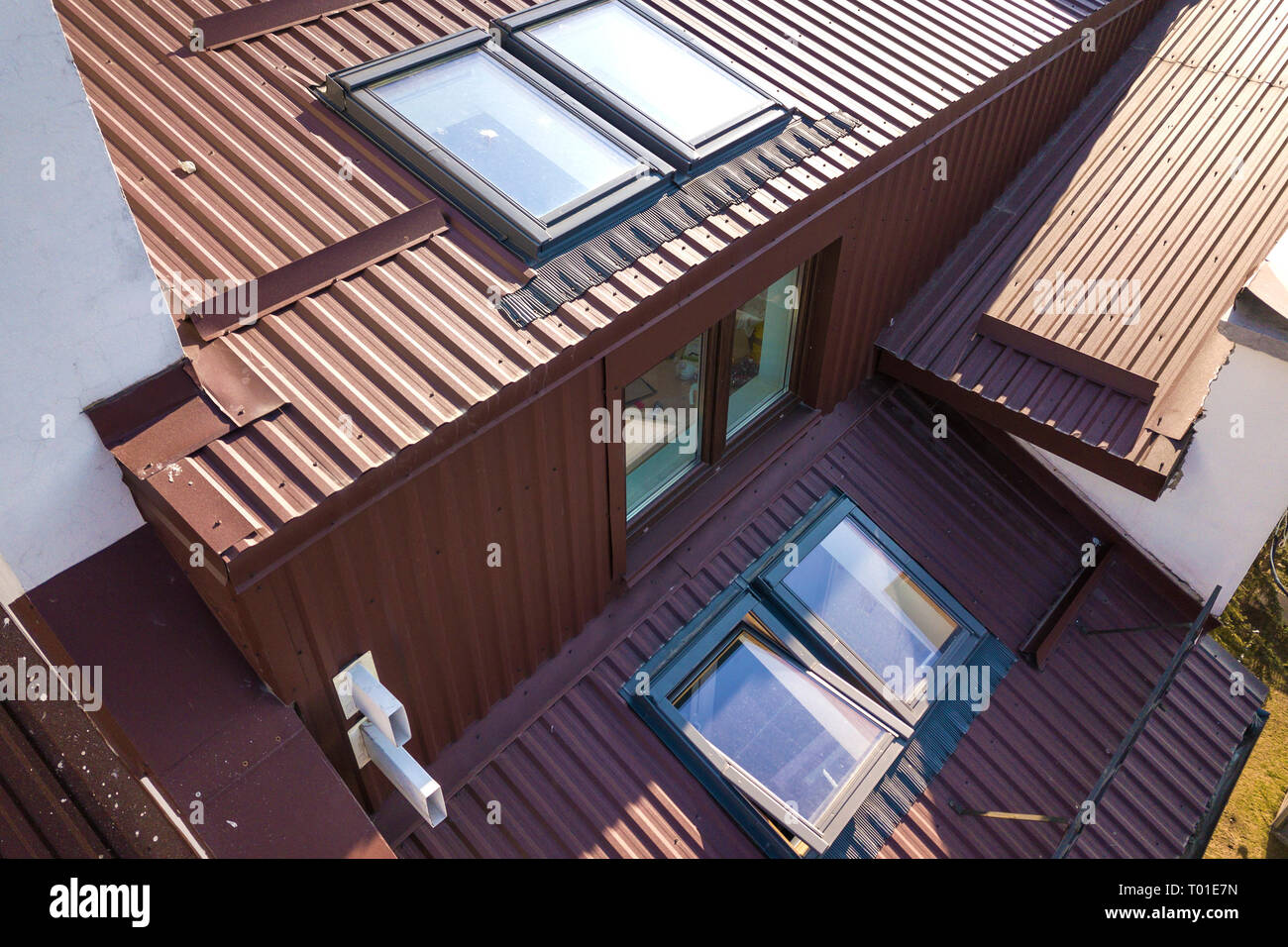 Aerial View Of Annex Room Exterior With Plastic Attic Windows Roof And Walls Covered With Brown Metal Decorative Siding Planks Stock Photo Alamy