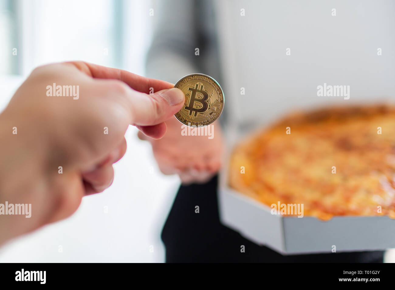 Bitcoin pizza day anniversary. The first reported exchange of cryptocurrency for a consumer product on May 22, 2010. Stock Photo