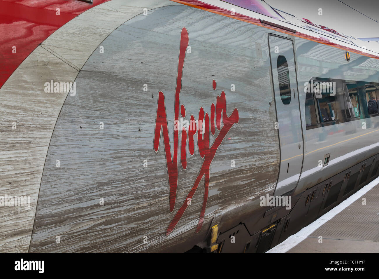 A dirty Class 390 Virgin Pendolino train at Platform 1 of Glasgow Central Station - Stock Image
