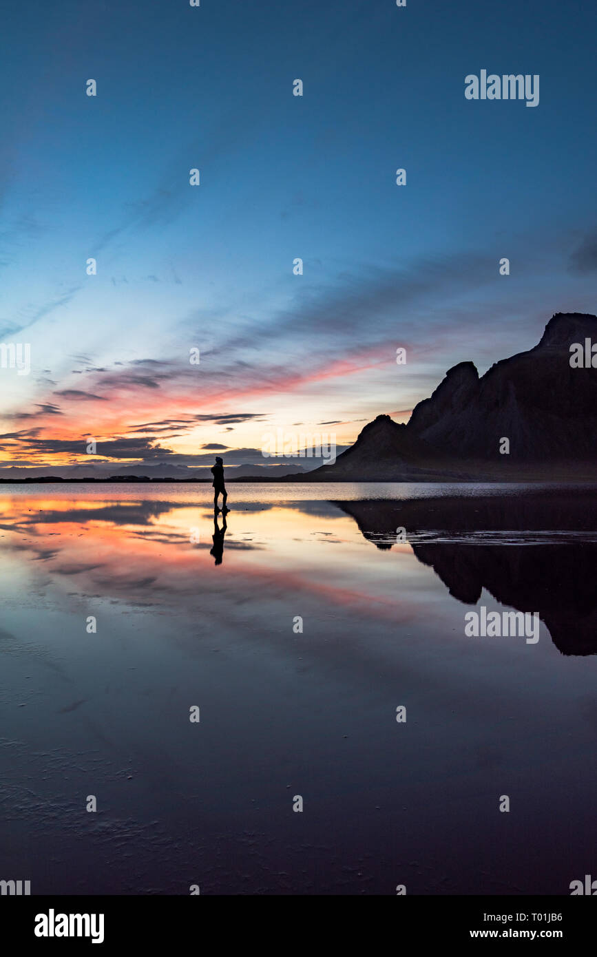 Reflection of girl during sunset - Stock Image