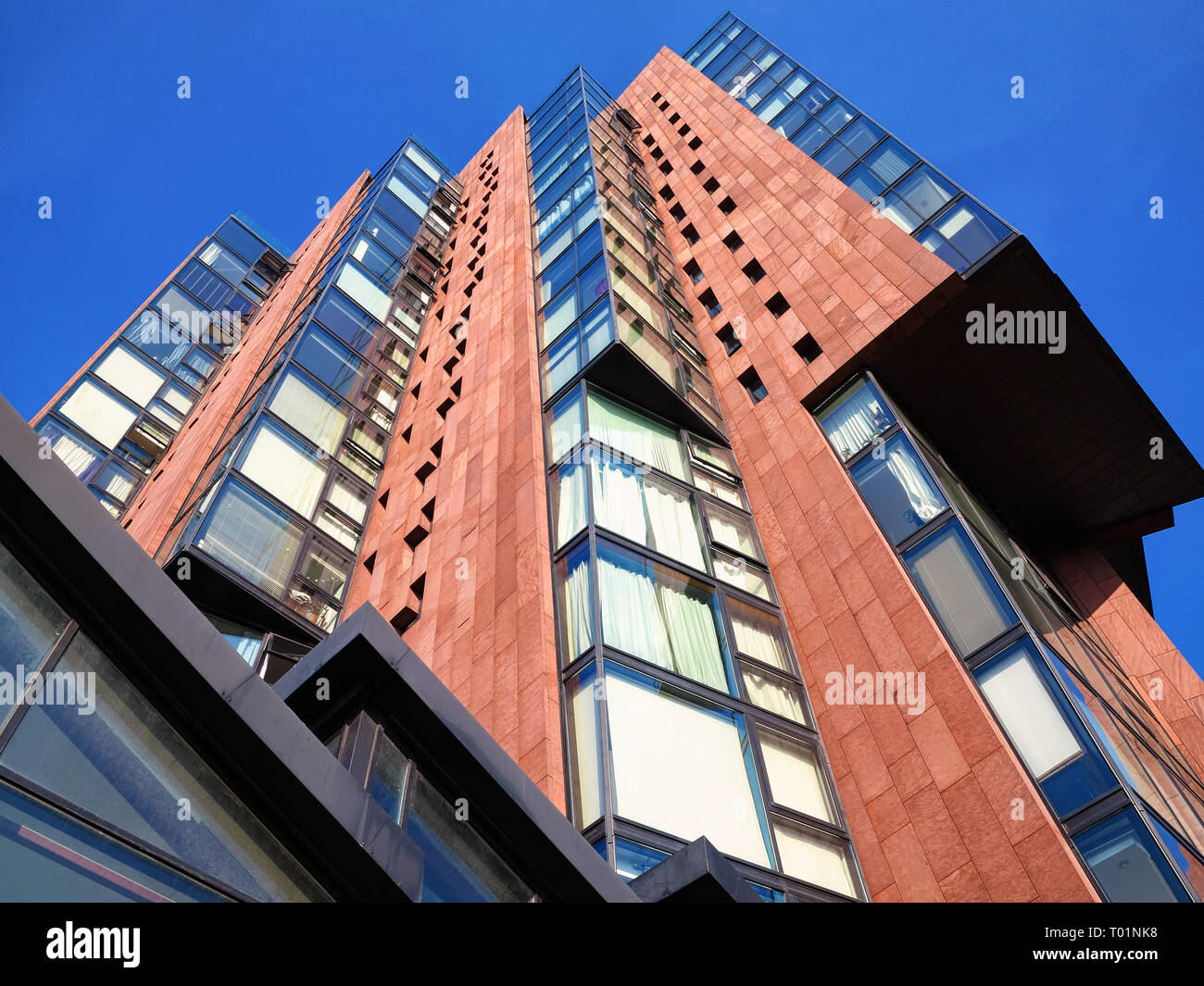Looking up at a residential tower block near the Ashton Canal, Manchester - Stock Image