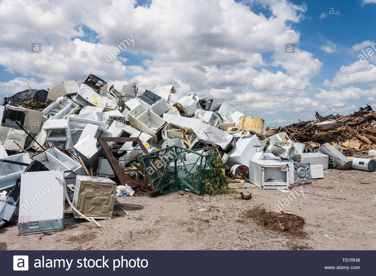 Aluminum and wood recycling area of landfill site - Stock Image