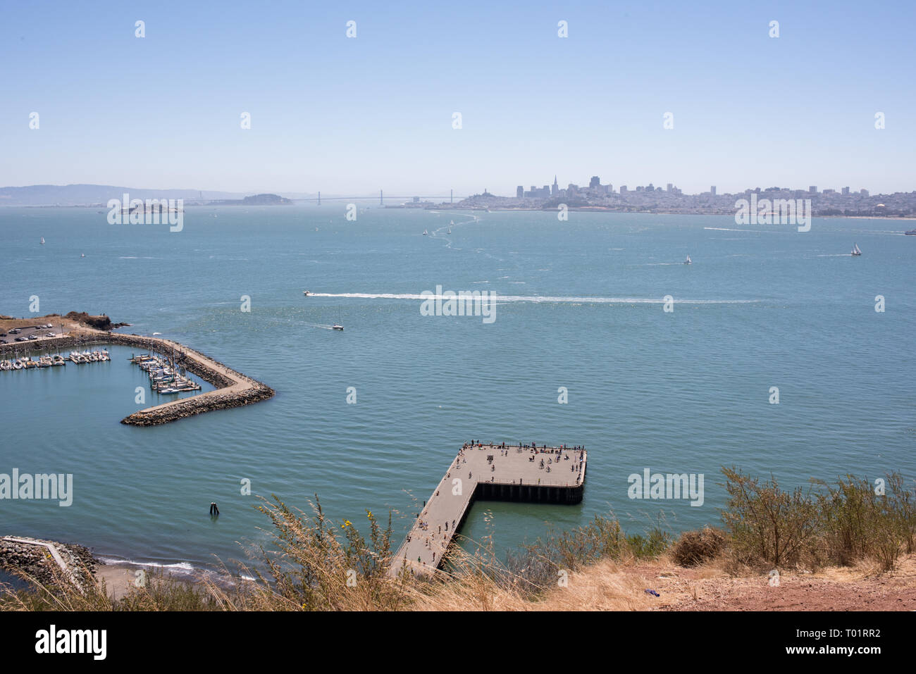 The iconic Golden Gate Bridge of San Francisco, California is seen here on a rare, sunny day, revealing the entire expanse of the bridge. - Stock Image