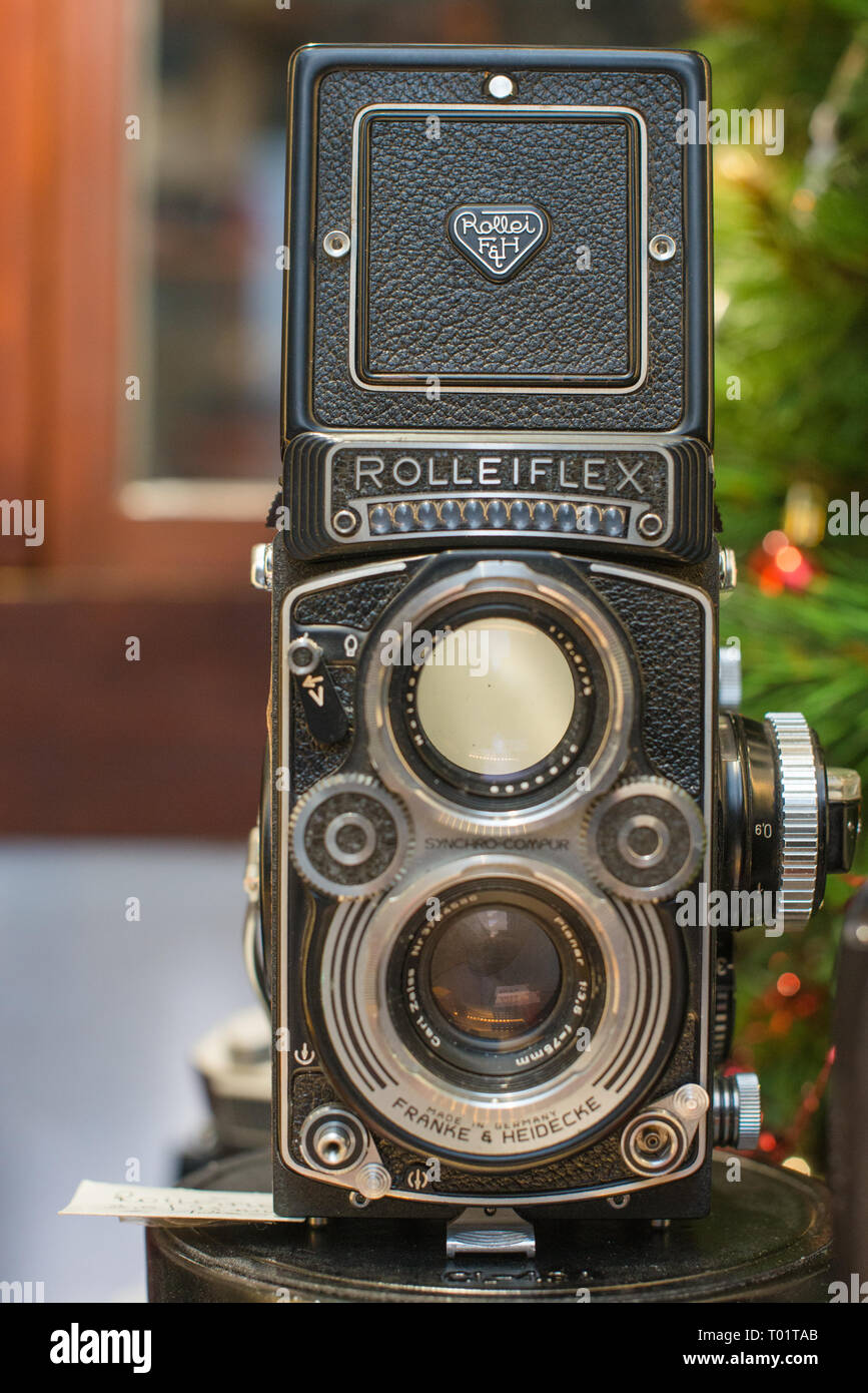 A Rolleiflex 3.5E Planar TLR camera with viewing hood open and magnifier raised. Stock Photo