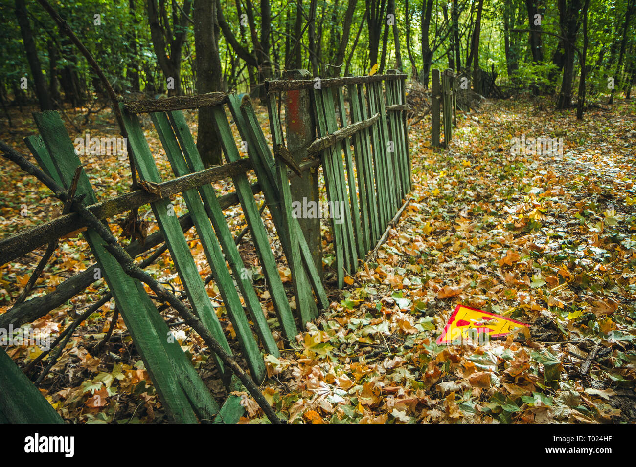 Radiation Sign - triangular warning yellow sign of radiation hazard in the zone of radioactive fallout in Pripyat city. Chernobyl exclusion zone - Stock Image
