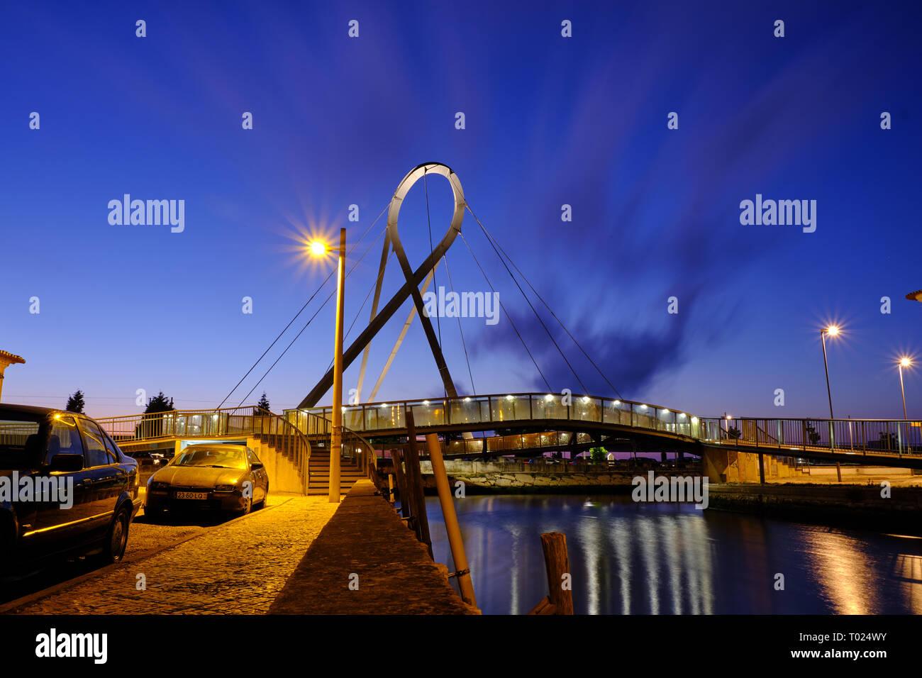 """Ponte Pedonal Circular"" (circular pedestrian bridge) in Aveiro seen from canal during blue hour. Long exposure. In Aveiro Portugal, June 22, 2017 Stock Photo"
