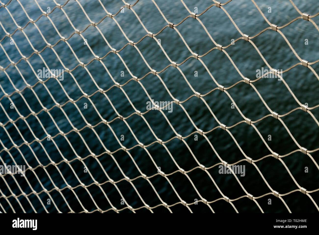 wallpaper chain fence water metal pattern wallpaper Stock Photo