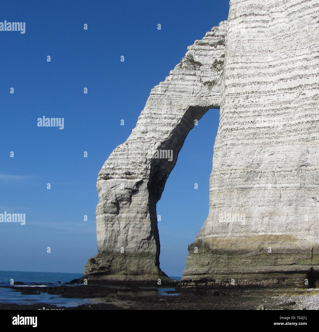 etretat france rocks occeoan cost landscape wallpaper - Stock Image