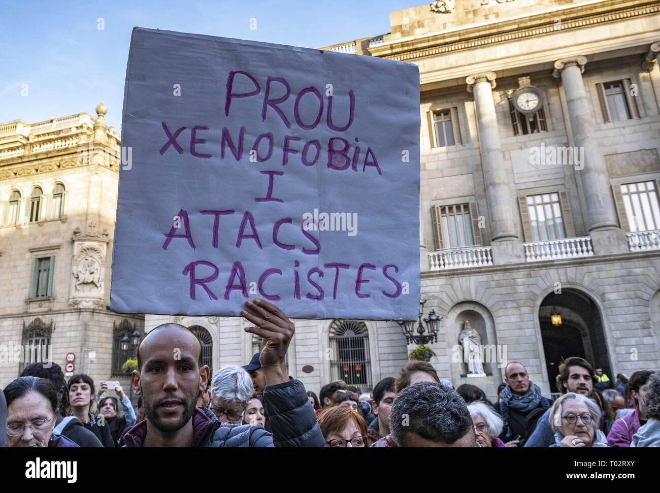 Barcelona, Catalonia, Spain. 16th Mar, 2019. A placard is seen showing a sign saying Enough of xenophobia and racist attacks.Around 300 people have gather to condemn the racism and discrimination after a racist attack carried out to a house of a young migrant after a fight between young migrants and young residents in Castelldefels area in Barcelona. Credit: Paco Freire/SOPA Images/ZUMA Wire/Alamy Live News - Stock Image