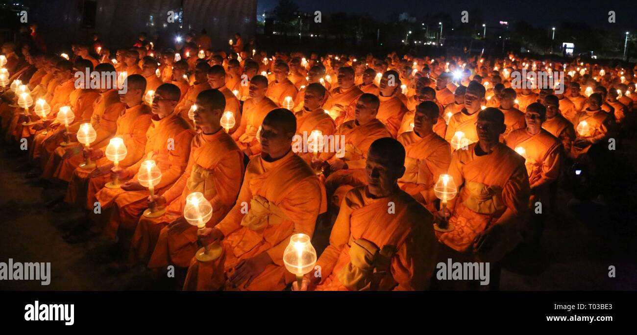 Kathmandu, Nepal. 16th Mar, 2019. Buddhist monks with lit lamps attend a mass prayer titled 'Light of Peace' to spread message of world peace through inner peace in Kathmandu. Thousands of Buddhist followers including monks from Nepal and Thailand gathered for the World Peace and also a memorial service for the people who lost their lives in the Earthquake 2015. Credit: Archana Shrestha/Pacific Press/Alamy Live News - Stock Image