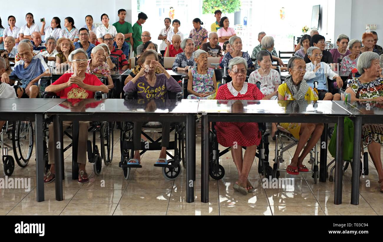 BOGOR, WEST JAVA, INDONESIA - FEBRUARY 2019 : A group of elderly people gather together in an elderly nursing home. - Stock Image