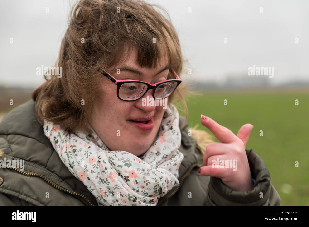 Hakendover, Flanders / Belgium - 03 02 2019: Portrait of a happy white woman with Down Syndrome and myopia - Stock Image