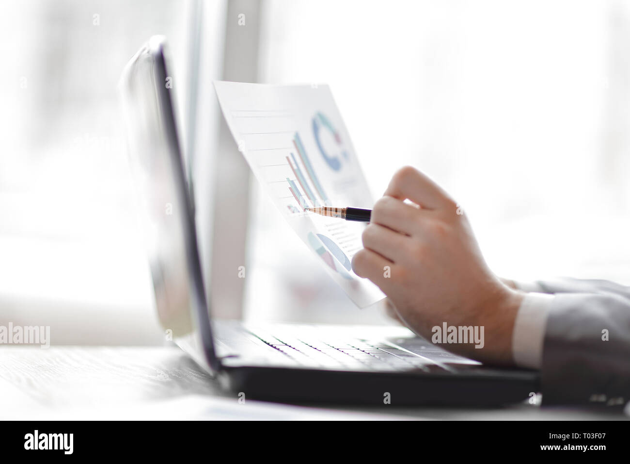 close up.the businessman checks the financial schedule - Stock Image