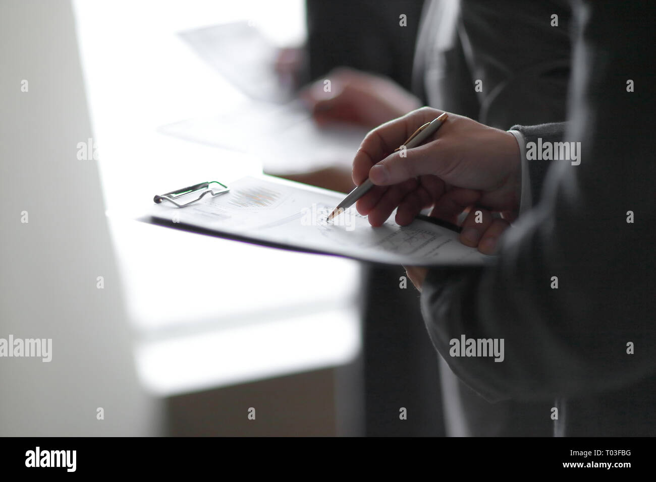 close up. businessman with clipboard checking statistics - Stock Image