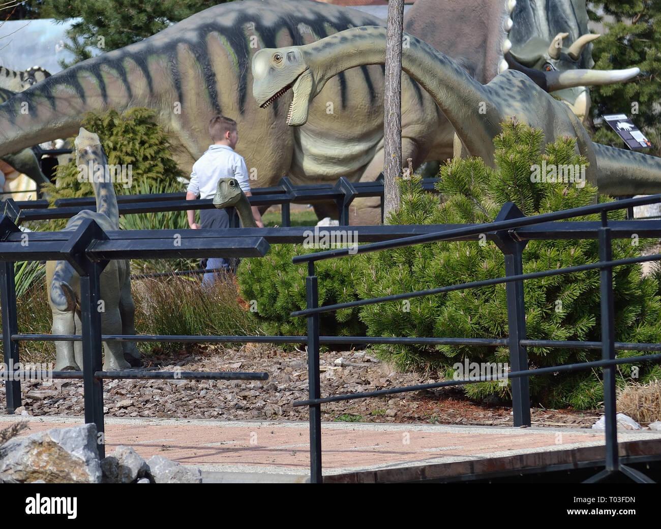 Boy visit the dino park Dinosville in Svilajnac, Serbia. - Stock Image