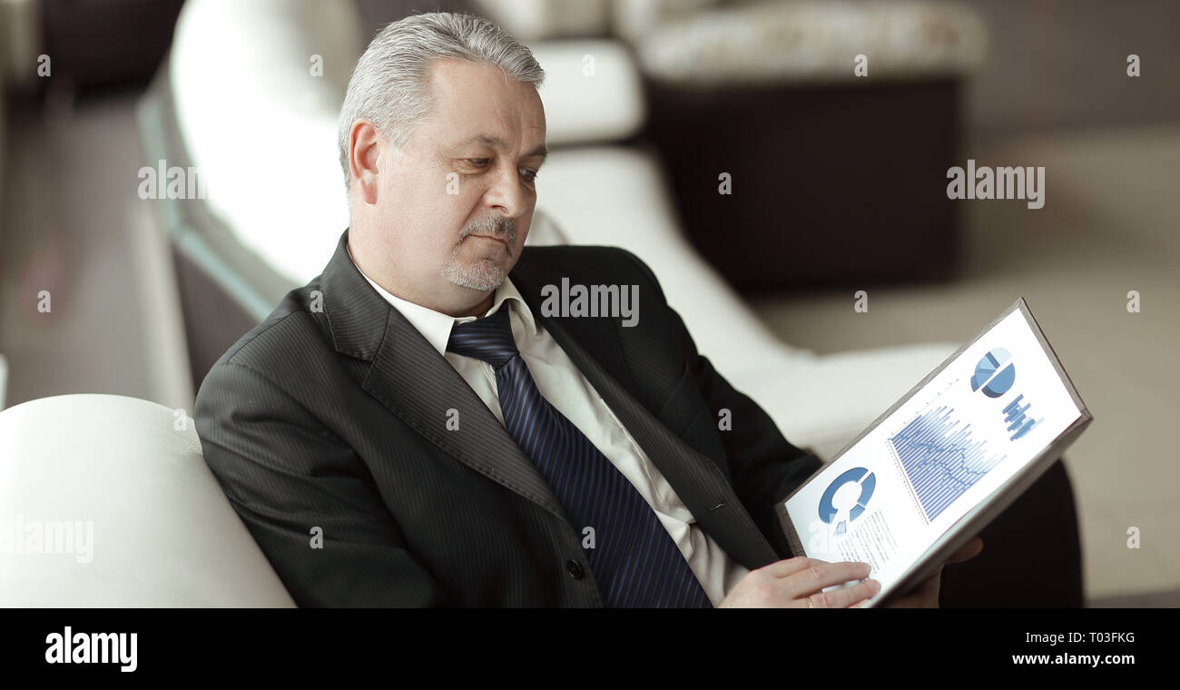 project Manager studies the financial data.business concept - Stock Image