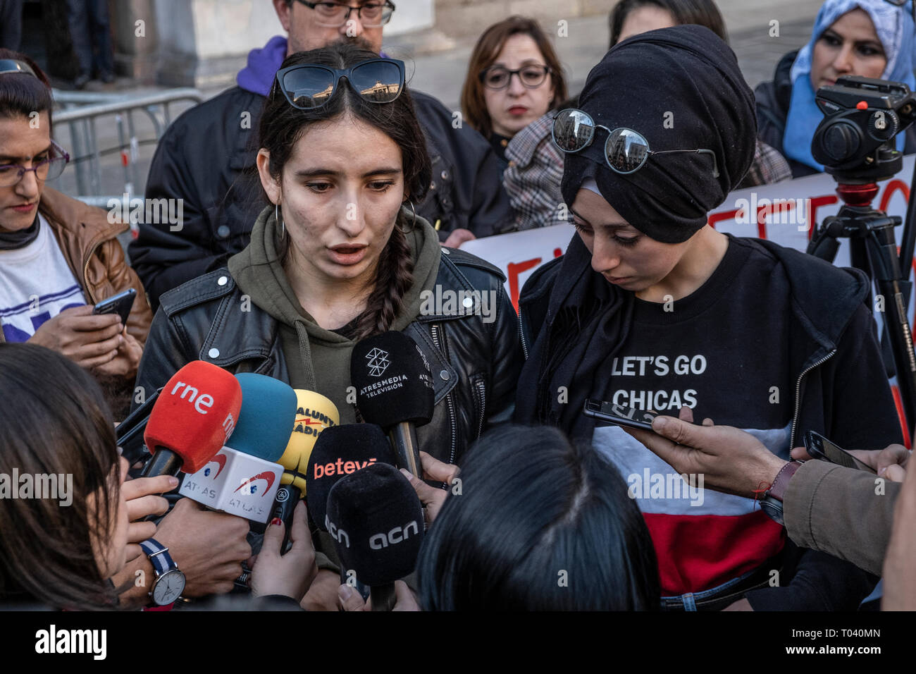 Spokespeople of young migrants are seen at a press conference. Around 300 people have gather to condemn the racism and discrimination after a racist attack carried out to a house of a young migrant after a fight between young migrants and young residents in Castelldefels area in Barcelona. - Stock Image