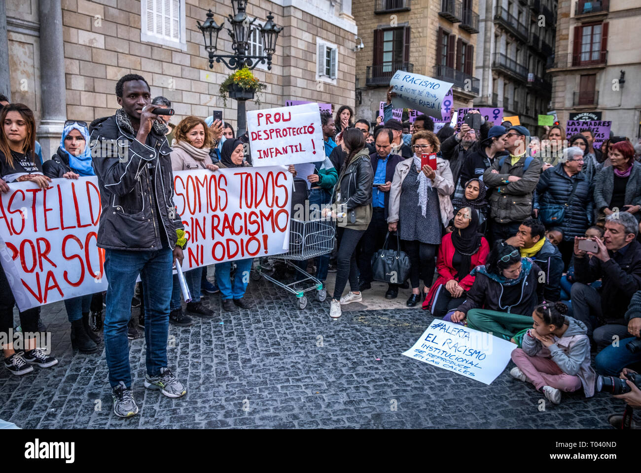 The spokesman of the Union of street vendors is seen during his speech. Around 300 people have gather to condemn the racism and discrimination after a racist attack carried out to a house of a young migrant after a fight between young migrants and young residents in Castelldefels area in Barcelona. - Stock Image