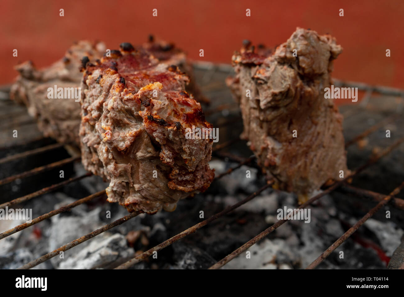 Cooking on artisanal grill a roast beaf. Meat for luhnc. Stock Photo