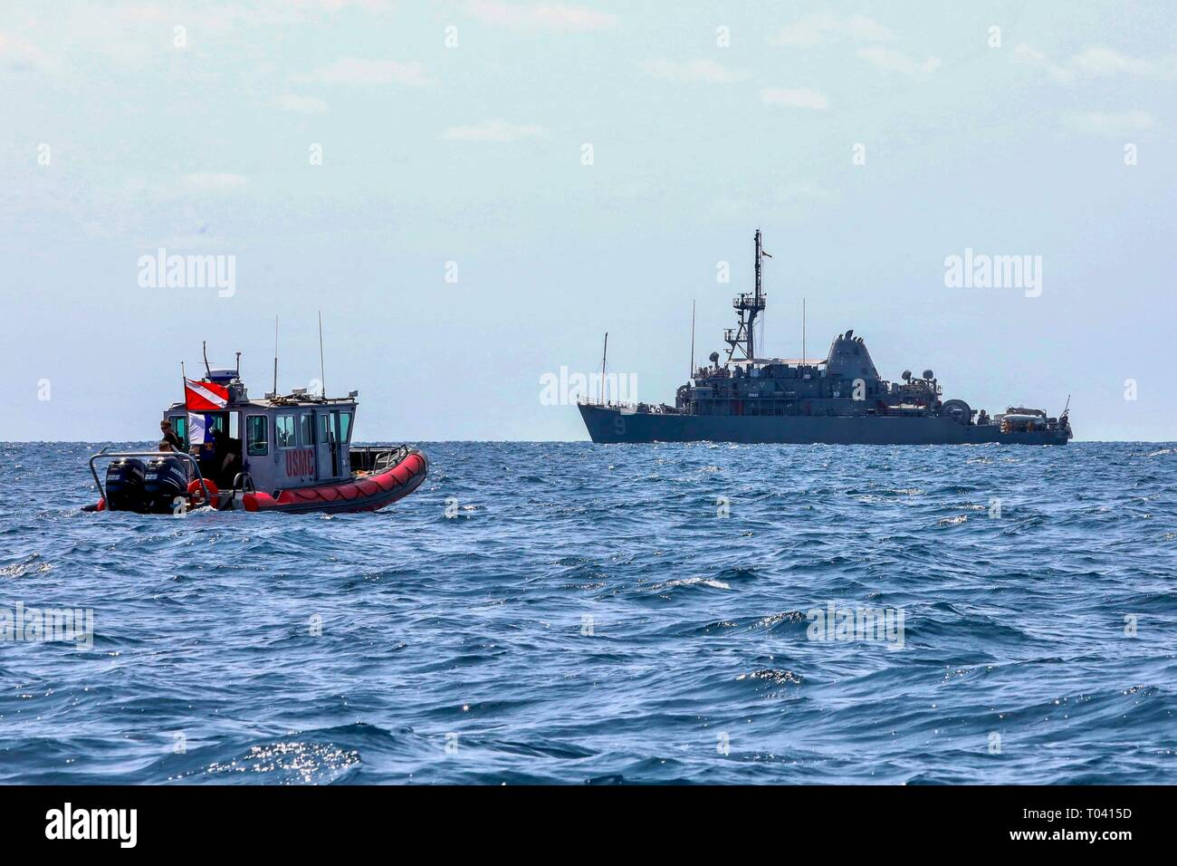 190314-N-AD347-1133 PHILIPPINE SEA (March 14, 2019) Marines assigned to 3rd Reconnaissance Battalion work with the Avenger-class mine countermeasures ship USS Pioneer (MCM 9) to conduct a mine hunting training exercise. Pioneer, part of Mine Countermeasure Squadron 7, is operating in the U.S. 7th Fleet area of operations to enhance interoperability with partners and serve as a ready-response platform for contingency operations. (U.S. Navy photo by LTJG Alexander Fairbanks) Stock Photo