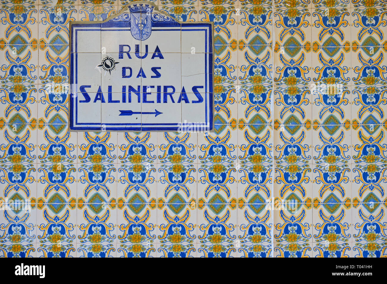 "Azulejos (blue tiles) street signs ""Rua das Salineiras"" on wall on blue and yellow tiles.  Aveiro, Portugal Stock Photo"