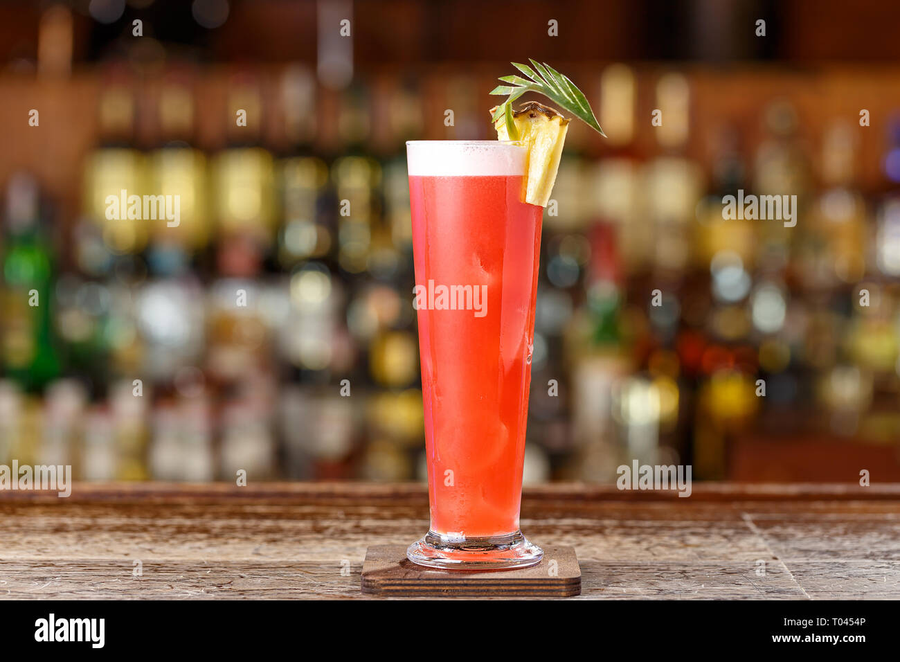 Alcoholic cocktail on the basis of gin, cherry, orange and liqueur 'Benediktin', grenadine, pineapple and lemon juice with the addition of bitter Ango - Stock Image