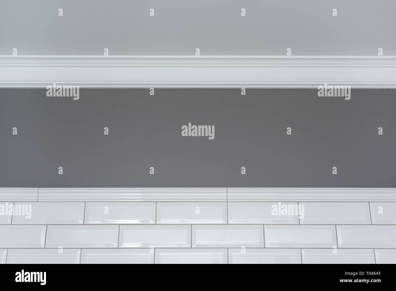Gray Painted Wall White Ceiling Molding And Ceramic Decorative Tiles Small White Glossy Brick Fragment Of The Walls Of The Bathroom Toilet Kitchen Stock Photo Alamy