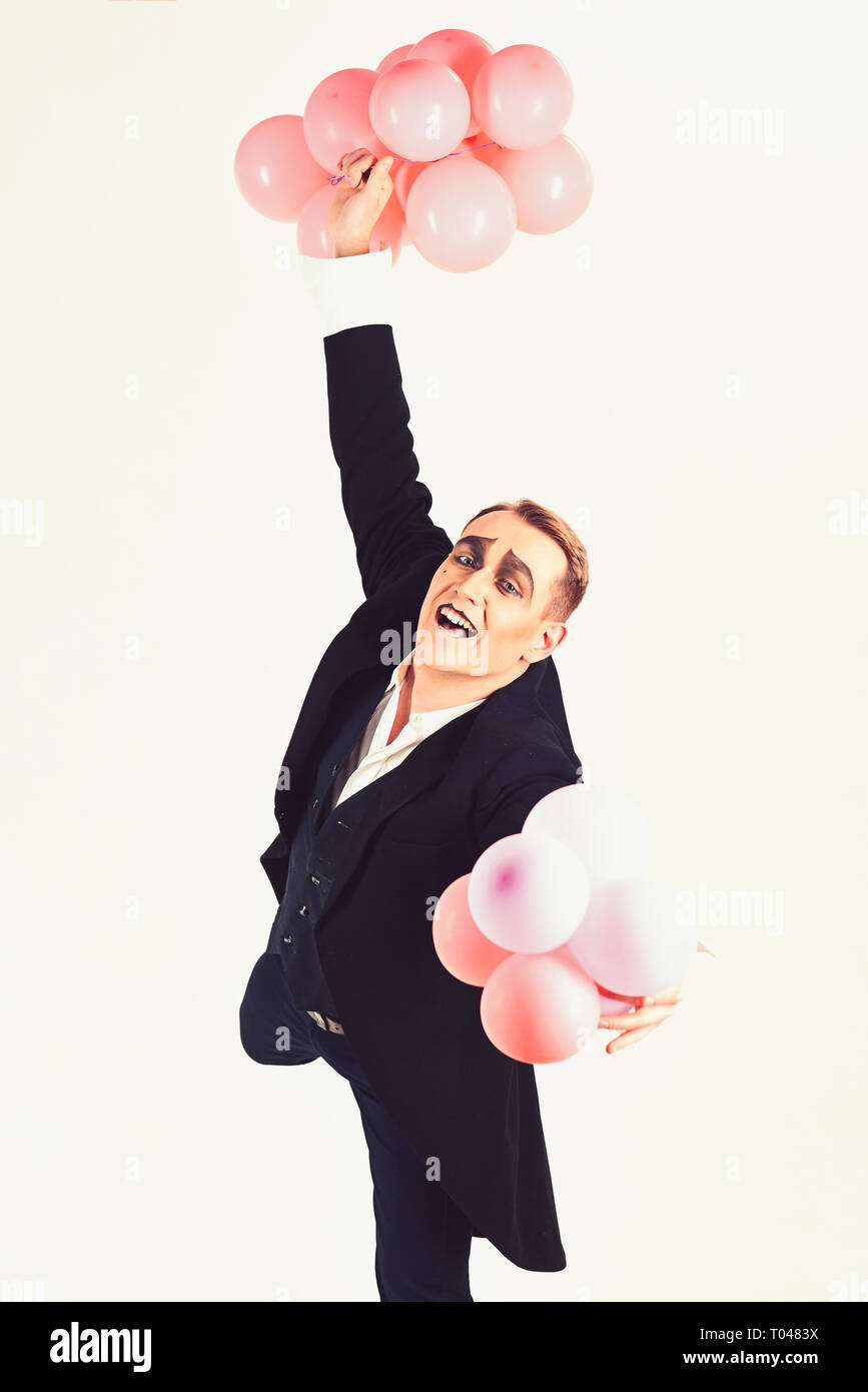 Happy birthday to someone who is forever young. Mime man with party balloons. Man with mime makeup on birthday party. Birthday or anniversary - Stock Image