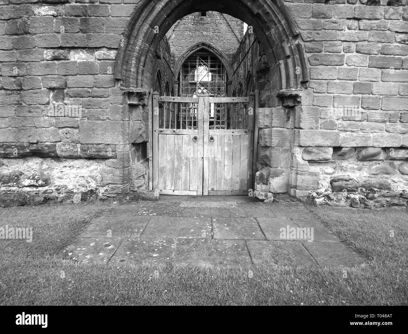Balck and White Archway at Sweetheart Abbey - Stock Image