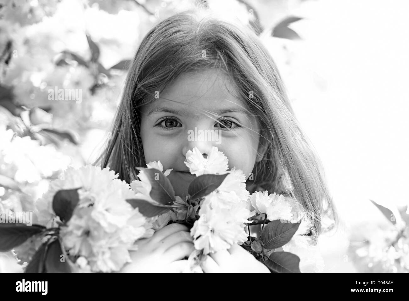 Springtime. weather forecast. Little girl in sunny spring. face and skincare. allergy to flowers. Summer girl fashion. Happy childhood. Small child - Stock Image